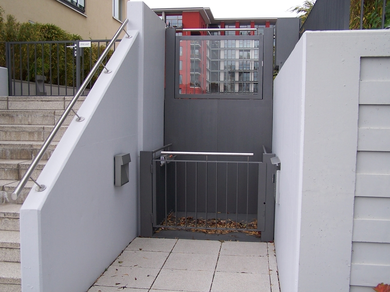 Disabled wheelchair access lift with gates