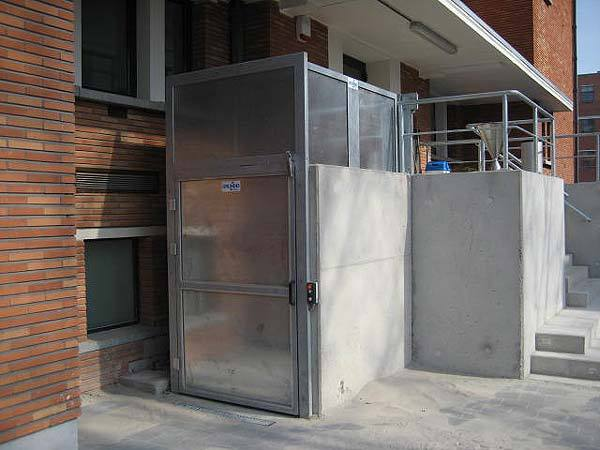 Exterior, weather proof goods and wheelchair lift fitted outside a Police Station