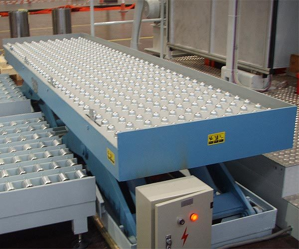 Scissor Lift with ball top transfer table integrated with feed and off-take conveyors