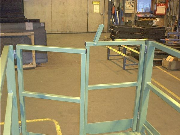 Scissor Lift Table with simple inward opening bi-parting safety gates and Bernstein SHS electrical interlocks